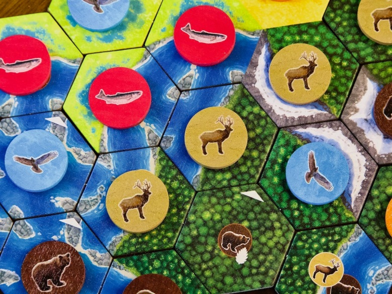 Tiles and wooden wildlife tokens in Cascadia Board Game by AEG and Flatout