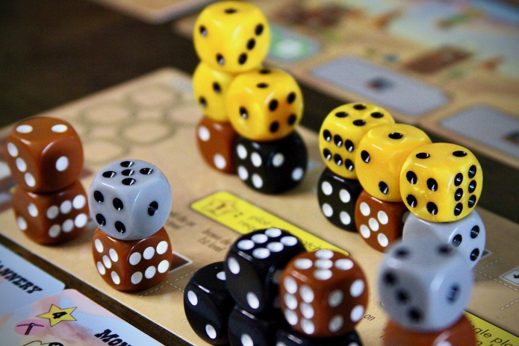 Dice city. The Main Street full of buildings in Tumble Town board game by Weird Giraffe Games