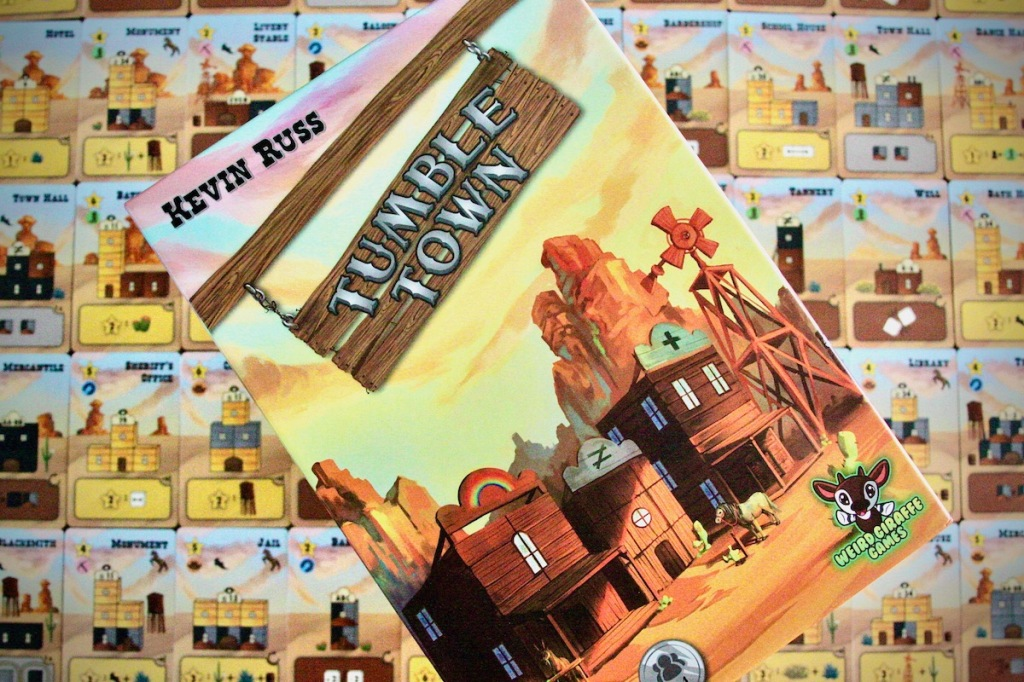 The box cover and building cards featured in Tumble Town board game by Weird Giraffe Games