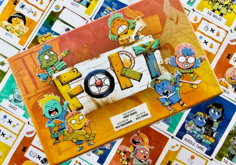 Box cover and kid cards in Fort by Leder Games