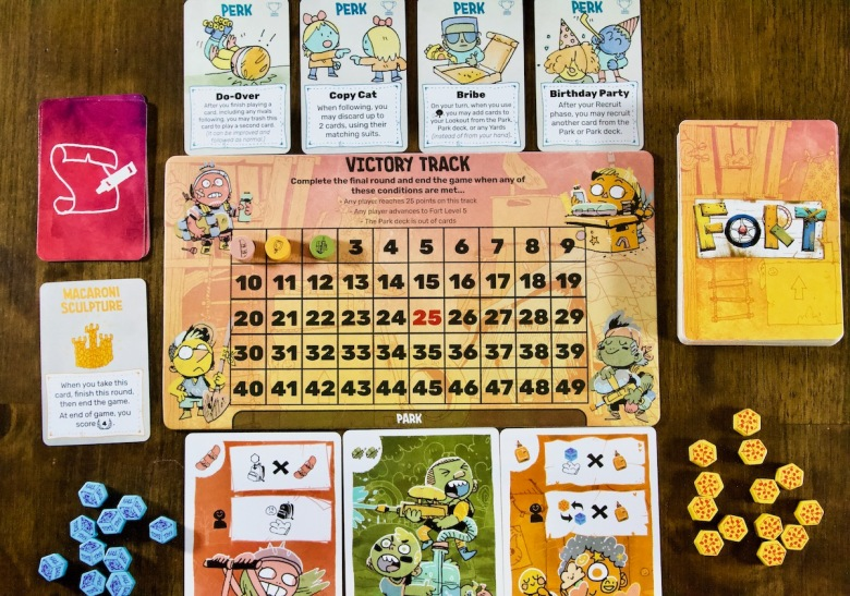 Scoring Victory Point VP Track for Fort by Leder Games including kids in the park who are ready to play, pizza, toys, perks, made up rules, and the macaroni sculpture