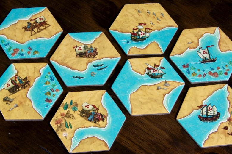 Land vs. Sea by Good Games Publishing Tiles Placement Board Game Ships and Caravans featuring many cultures