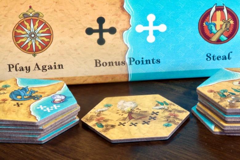 Land vs. Sea by Good Games Publishing tile drafting setup plus volcano and whirlpool tiles