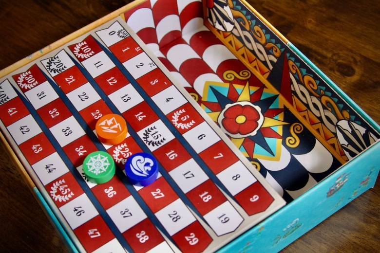 Multifunctional box insert in Land vs. Sea by Good Games Publishing - doubles as the score board and has lovely artwork