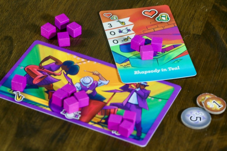 Player card, song cards, energy cubes and currency from Big Easy Busking by Good Giraffe Games
