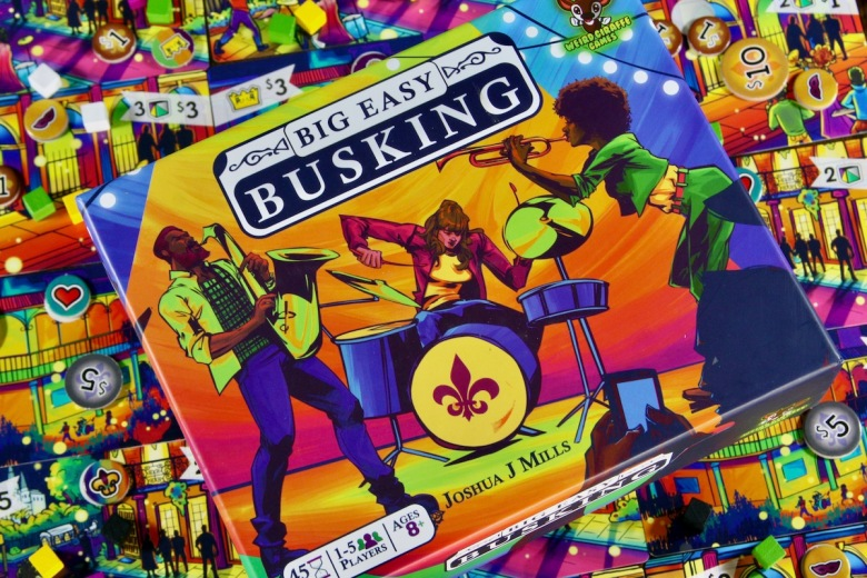 Colorful box art for Big Easy Busking by Good Giraffe Games featuring jazz musicians in New Orleans